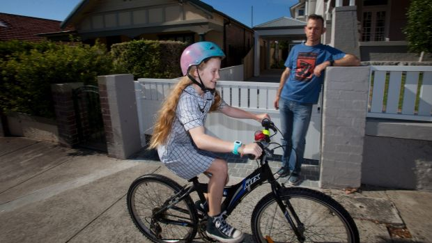 Callum Gordon with his daughter Macy Gordon-Heywood, who rides to school every day. Photo: Fiona Morris
