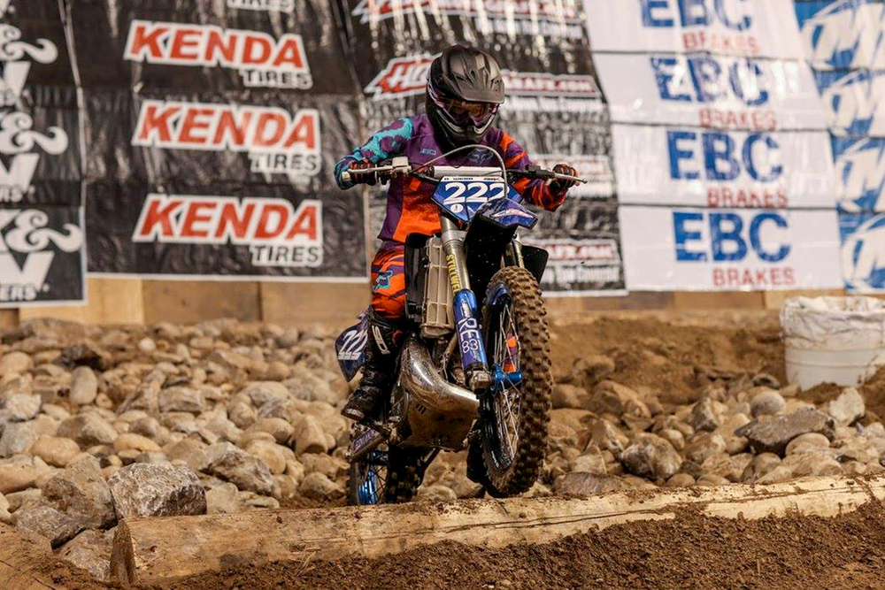 Regina Webb navigates the Endurocross rock garden.