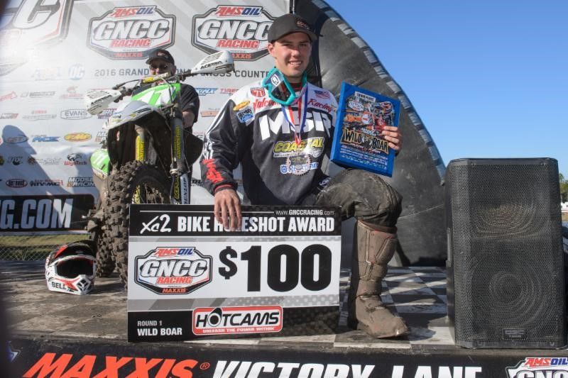 Craig DeLong is all smiles on the podium. Photo: Ken Hill.