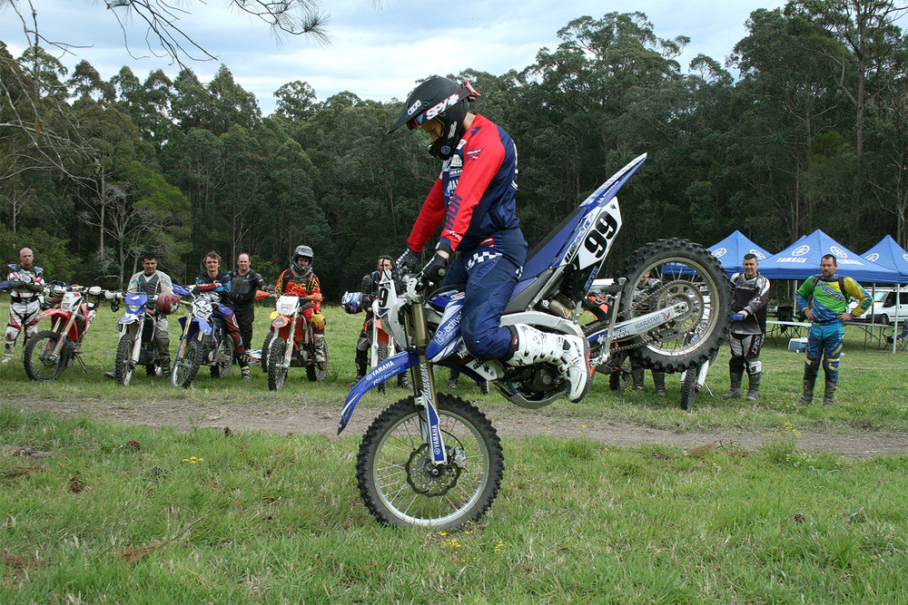 Green seated forward during a stoppie drill. | Offroad Advantage image.