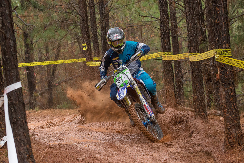 Josh Toth kicks up dust from under the mud on his way to third overall. Photo: Shan Moore