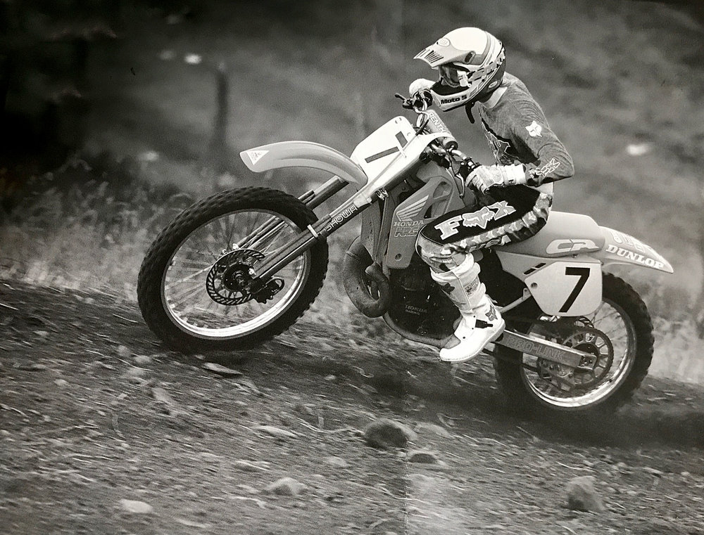 "Taylor ""testing"" Jeff Stanton's factory bike at Unadilla. We can only imagine how difficult this was. (Insert laughing face here.)"