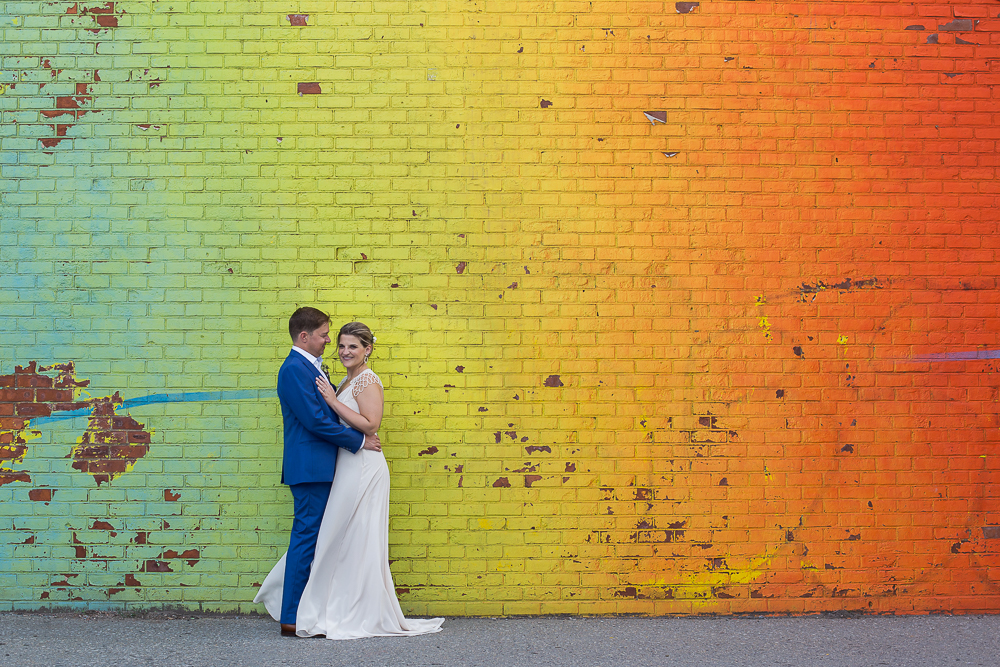 Kate Alison Photography Fleet Alley Rainbow mural DUMBO Brooklyn, NY wedding couple.