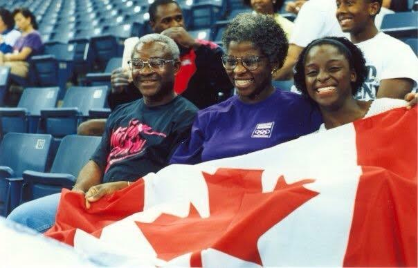 The Umeh family cheers on Stella at the 1991 World Gymnastics Championships.