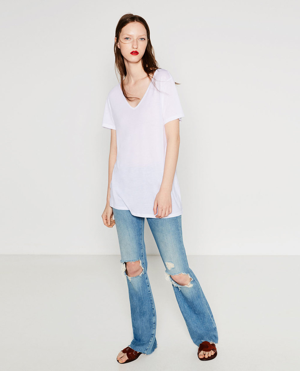 ZARA  - Extra long tee in 3 colors: White, Black and Grey. Nice low v-neck and long in the body.