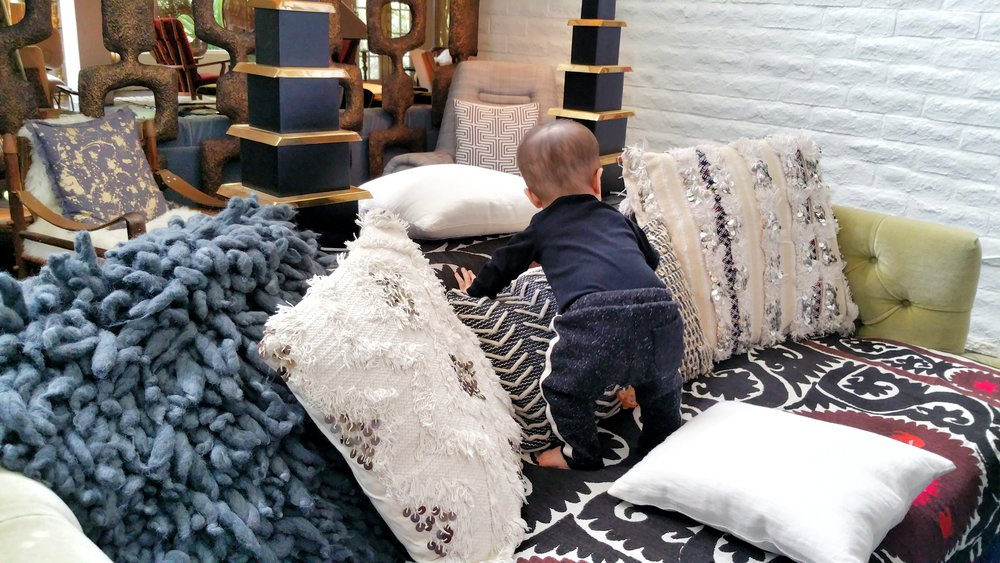 Arranging the sofa pillows at The Parker Hotel.