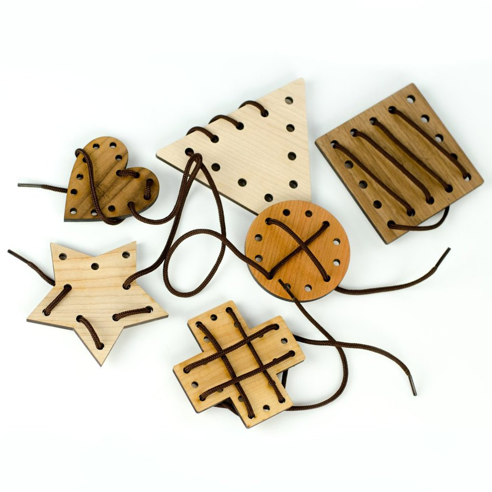 Geometric Lacing Toy - This wooden Lacing Toy helps children develop fine motor skills and shape recognition. This beautiful six-piece set includes a circle, triangle, square, heart, plus sign and star.