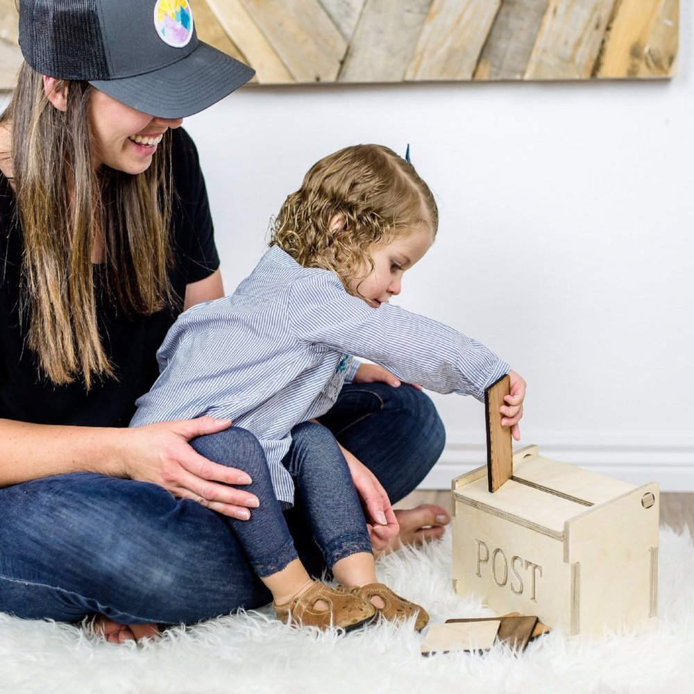 Mailbox Toy - This wooden mailbox and letter toy can grow with your child. At first they can practice putting the letters into the box and when they are older they can pretend to write letters and send them off to their friends and family.