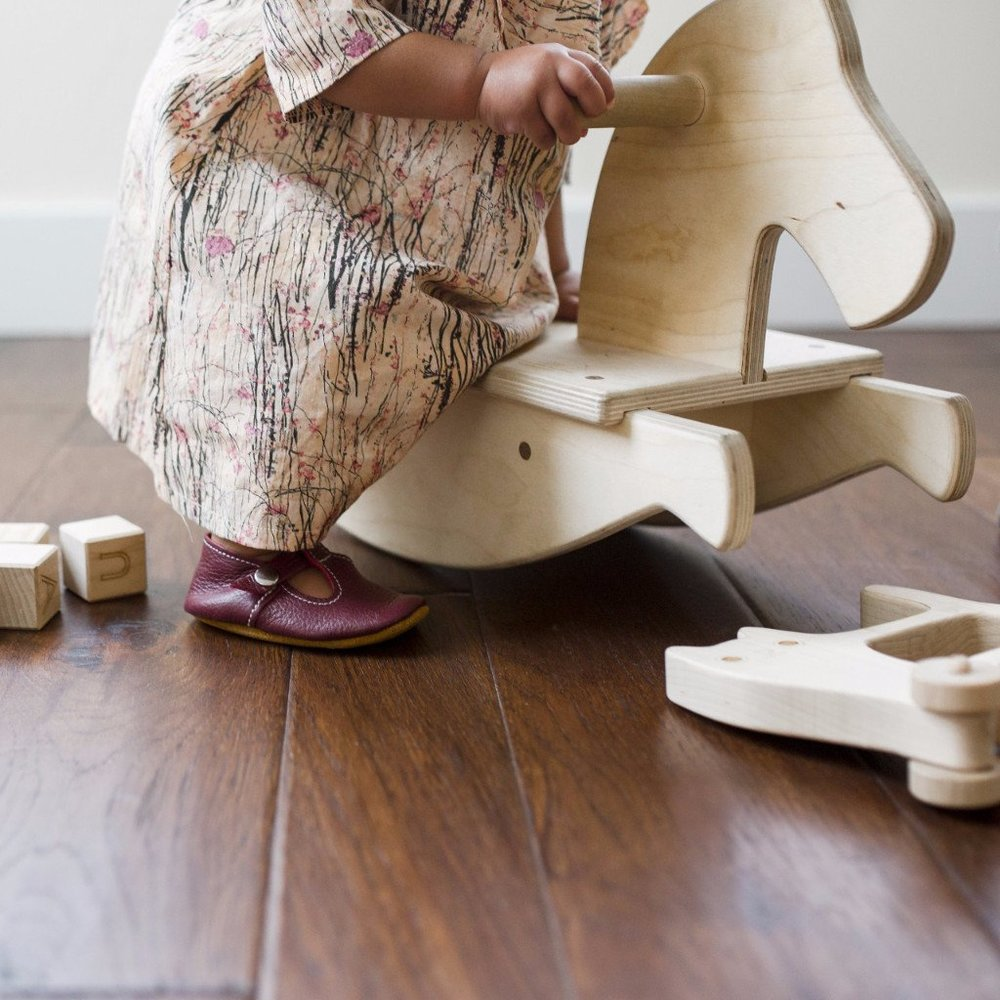 Wooden Rocking Horse  - A Rocking Horse is a perfect toy for gross motor development while the rocking movement can provide a soothing sensory experience for little ones. Kids will love the design and you will love that it is a safe and sturdy riding toy.