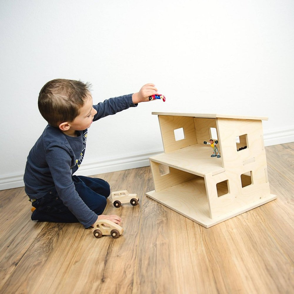 Wood Dollhouse - Dollhouse play is an amazing skill building activity. We love the simple design of this house and the opportunity it allows for a child to decorate and paint it just the way they want.