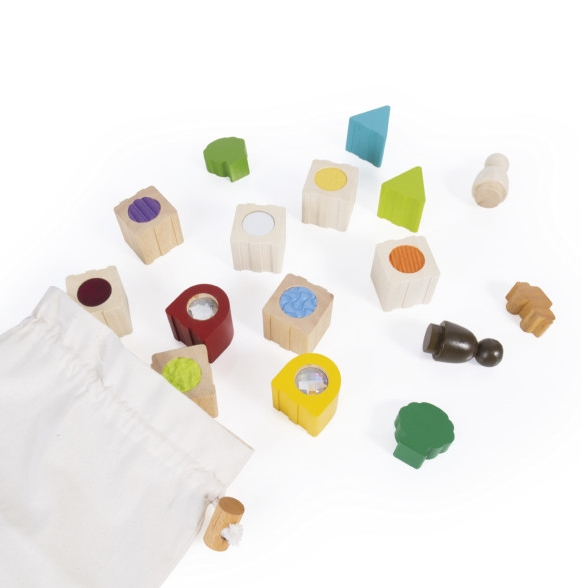 Guidecraft Sensory Stacking Blocks - These Sensory Stacking Blocks set encourages tactile and sensory exploration. The 12 chunky rubberwood building blocks come in a variety of shapes with various inset textures invite your child to build houses and buildings and by connecting the blocks with simple joints.