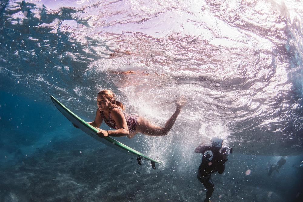 female surfer pipeline