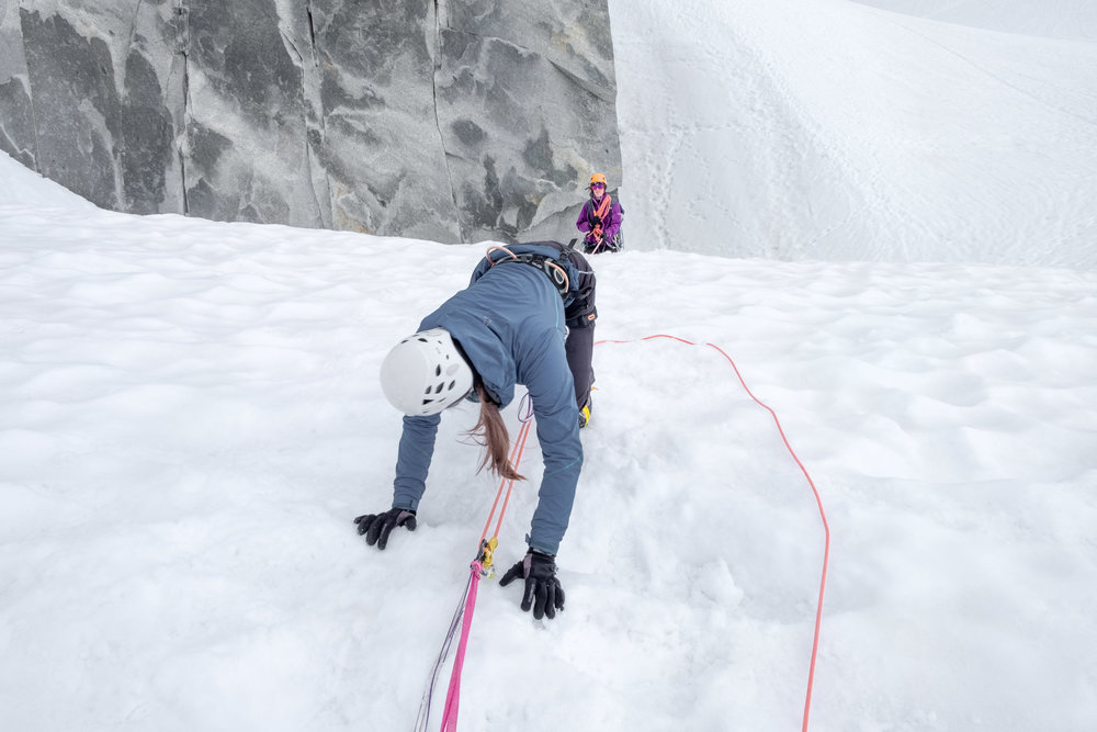 Sophie uses a Z hoist to rescue Rosa from a crevasse.