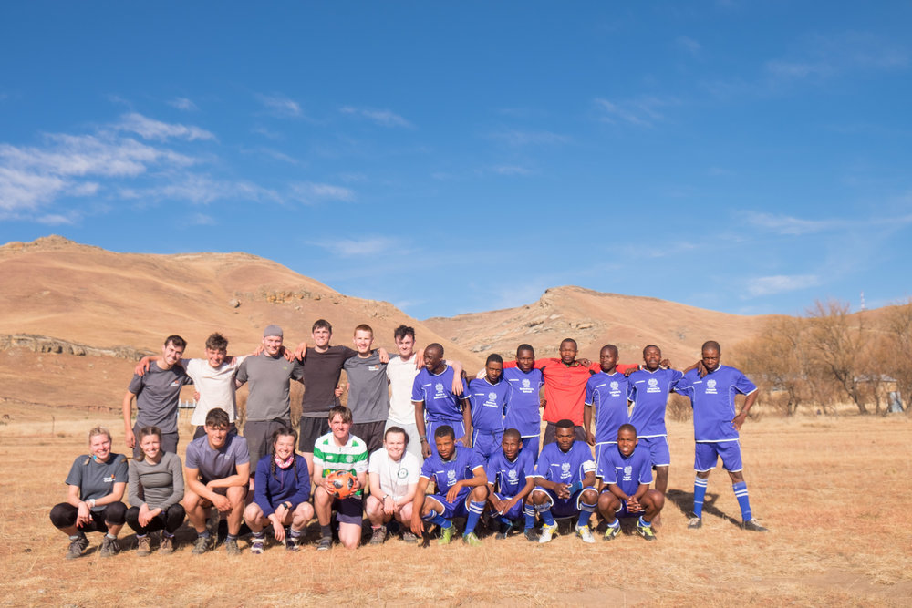 Being invited to take part in a football match in Lesotho.