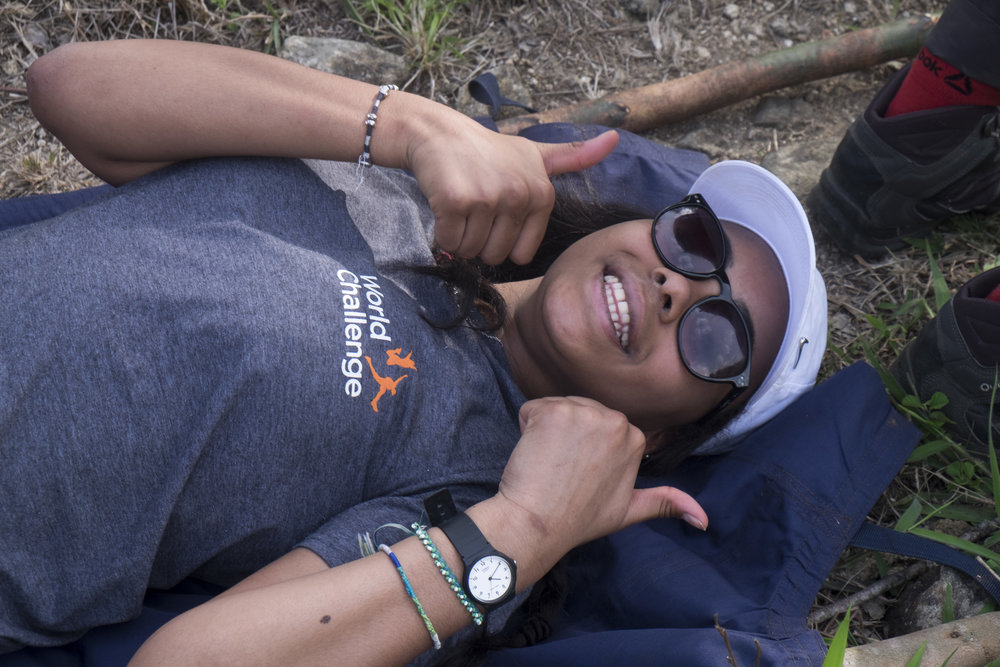 A team member gets ready to be stretchered to the road after spraining her ankle while trekking.