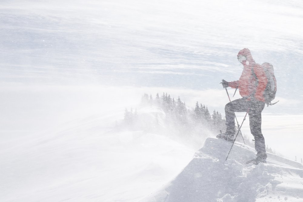 Zlatko snowshoeing across a blustery Velika Planina.