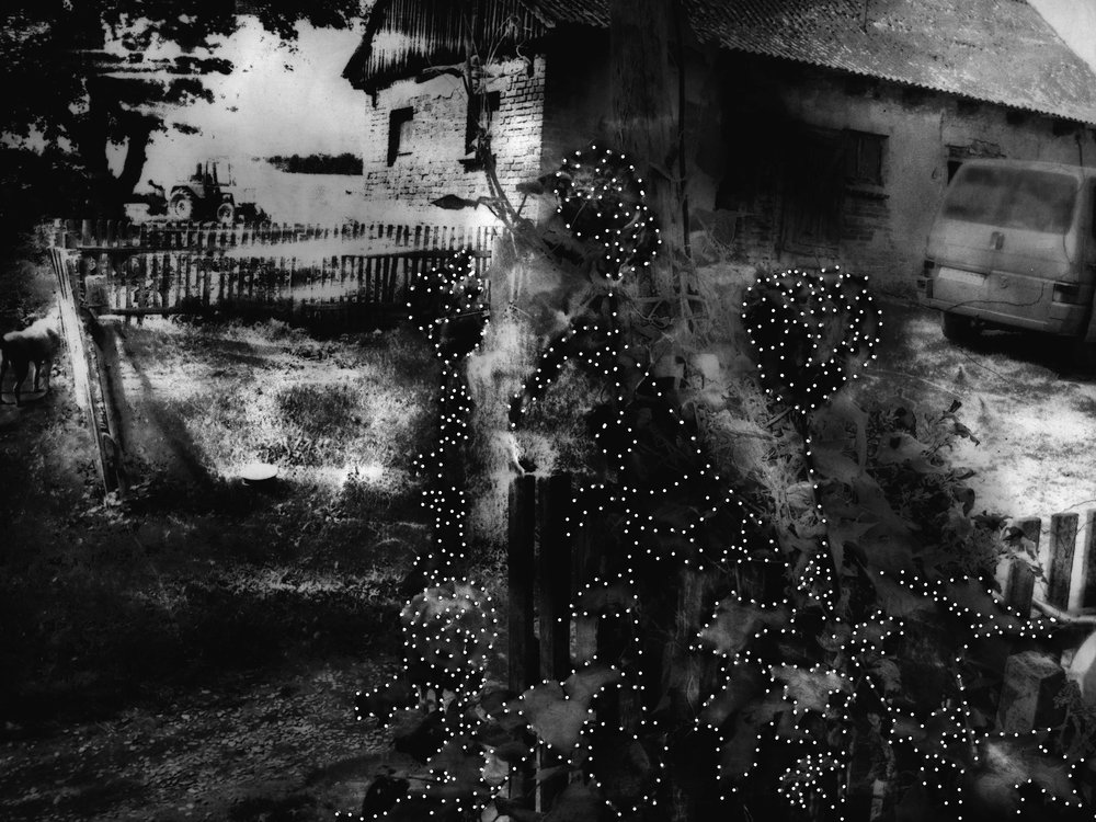 An old family photograph, scanned, scrubbed to remove ink, stitched through with mending thread, turned into a negative and printed in the dark room. From my project, The Farm, 2011.