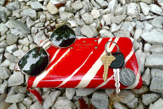 Kate Spade wallet, gold sunglasses and keys