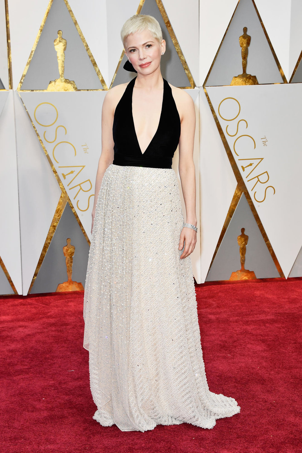 This silhouette was made for Michelle. Michelle Williams in Louis Vuitton