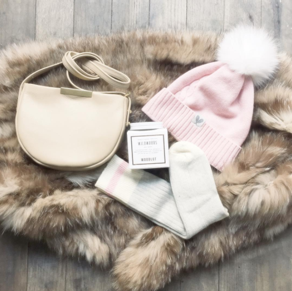 Cashmere pom hats and socks and buttery soft leather. Photo from @tuckshopoutpost