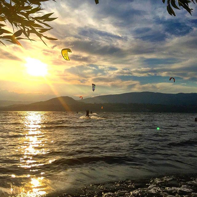 Kite surfers. It's our kind of sport.  #Kelowna #rotarybeach #kelownabc #okanagan #beachlife #kitesurf #kiteboarding #kitesurfing #waves #sunset
