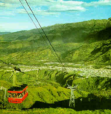 The Andean city of Merida lies on a valley table-land at an altitude of 5,397 feet (1,645 m.). A cablelift, the highest in the world, operating in four sections, takes sight-seers from the city of the Pico Espejo glacier (Mirror Peak), at an altitude of 15,330 feet (4,675 m.). To reach this peak, the cable cars ascend over a distance of some eight miles (12.3 km.).  A spectacular view of the Sierra Nevada (Snow-covered Range). The Pico Bolivar (Bolivar Peak), in the background at the left of the picture, rises to 16,423 (5,007 m.), from a series of jagged precipices.