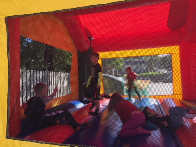 Kids enjoying some jump time. Who doesn't love a bounce house!