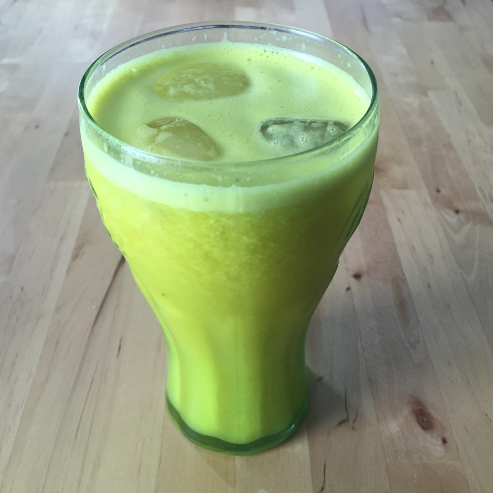 Pineapple, cucumber, lemon, ginger and turmeric juice