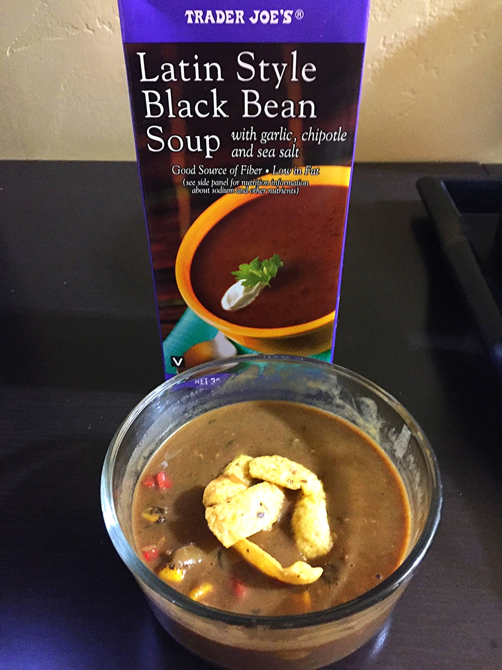 Black bean soup with meatless grounds, roasted corn and fajita veggies