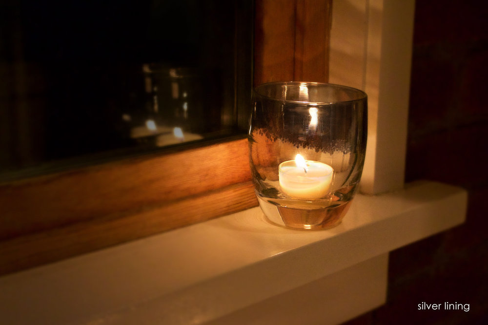 Sustainable, hand-blown 'silver lining' votive by glassbaby