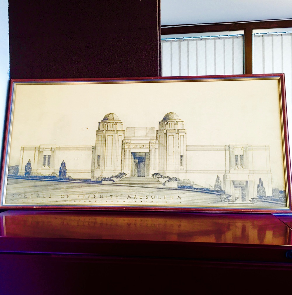 An architectural drawing of the Portals of Eternity mausoleum in the offices of the Hills of Eternity Memorial Park. — N.M-Y. '15