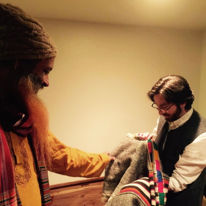 "Ibrahim Baba and I in Rabbi Zalman Schachter-Shalomi's prayer room, looking at the very first ""Rainbow Tallit."" Photo by Issa Farajajé, 2015."