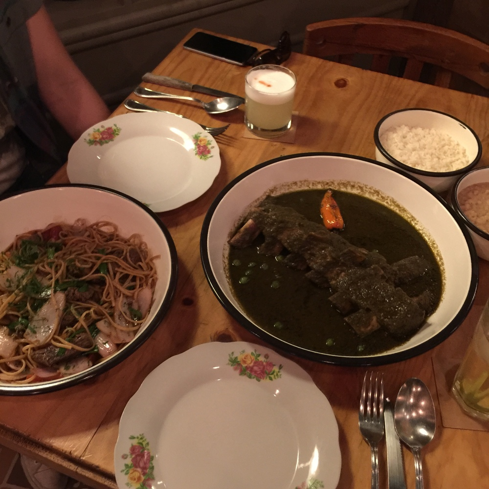 Chifa steak and noodles dish (left) and braised short rib in a cilantro based stew (right) at Isolina in Barranco (Lima), Peru.