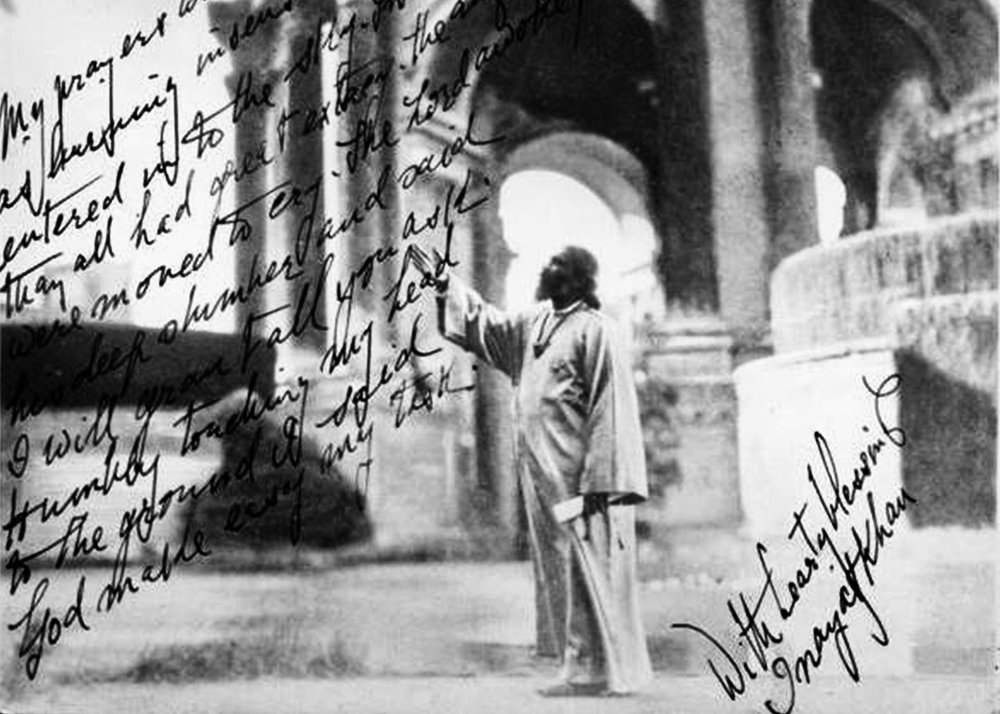Postcard of Hazrat Inayat Khan in front of the Palace of Fine Arts which he has signed.