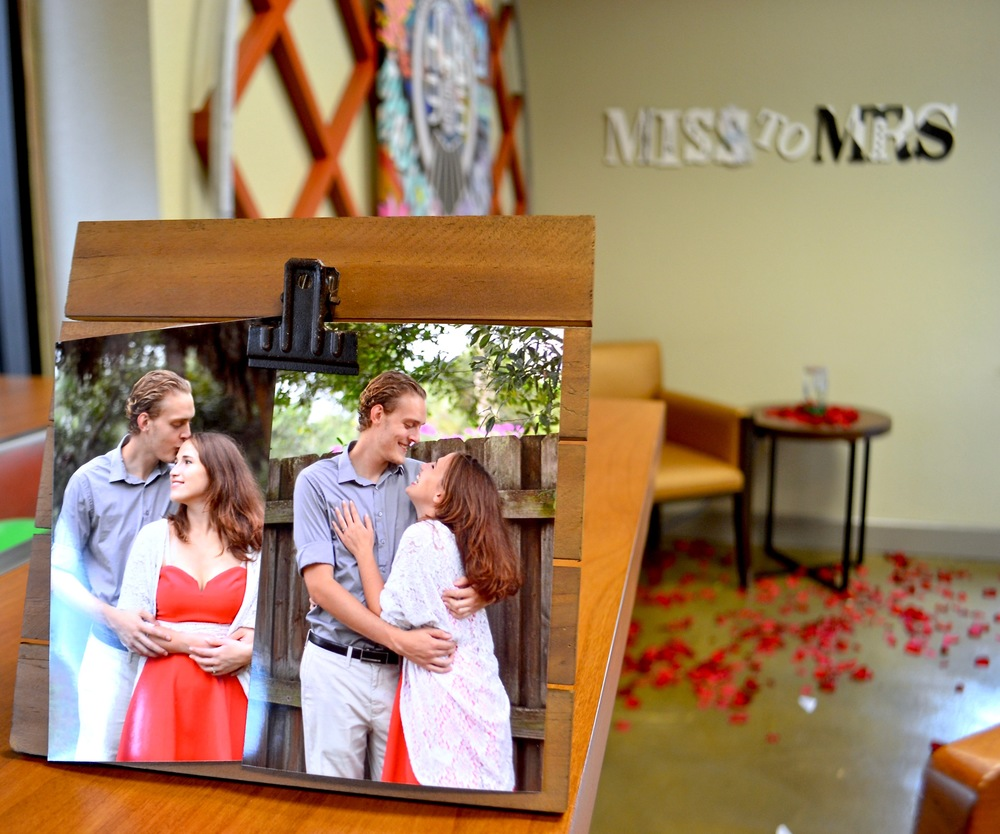 """Pictures of the bride and groom with scattered rose petals on the floor and """"Miss to Mrs."""" sign on the wall displays some ways Hub 925's flexibility for inexpensive decorations. Kim-E's Flowers gave rose petals for this party -free!"""