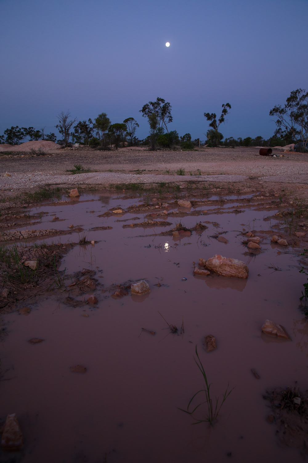 The full moon reflected in some mud pools at Lightning Ridge in the opal fields
