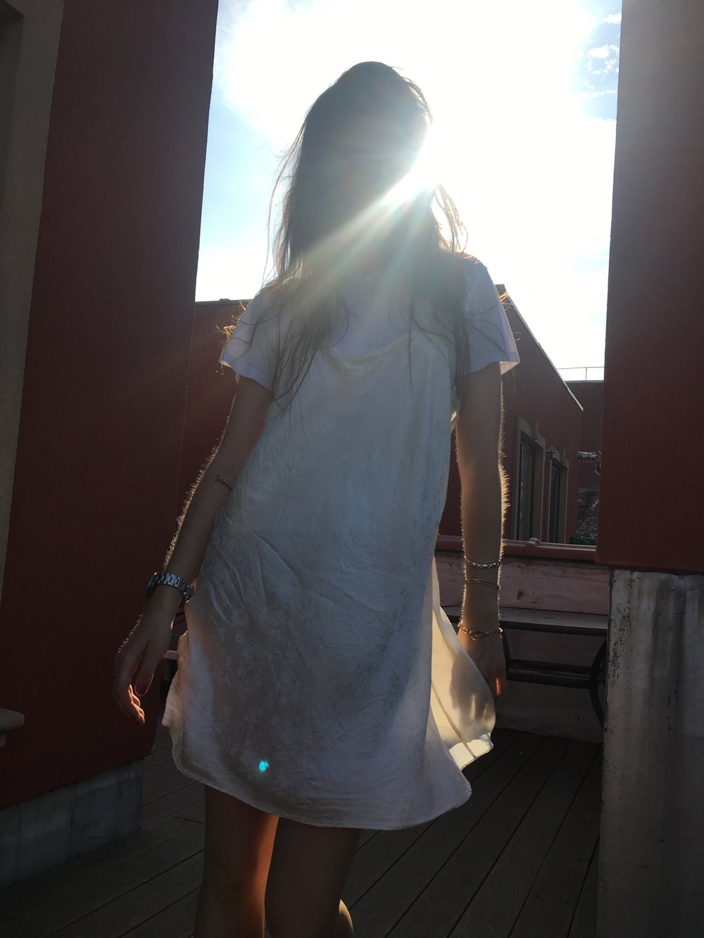 Wearing my favorite slip with the sun making magic up on Therese's roof in Brooklyn. Photo via Instagram: @coolandthoughtful.