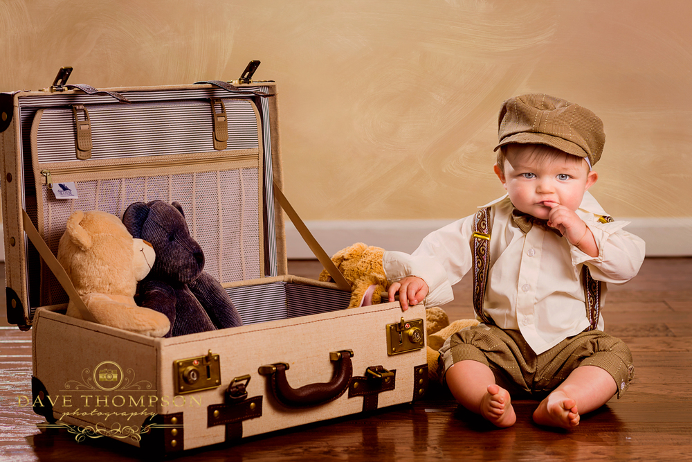 Another fund family photo.  The background was modified to add a texture, adding interest.  The suitcase and stuffed animals add whimsical fun to this toddler photo.