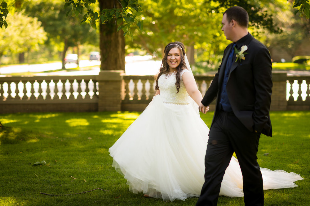 Bride Walking with Groom at Ruthmere Mansion