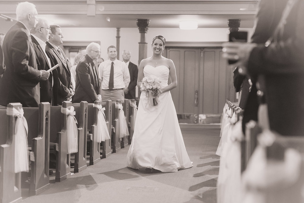 Smiling Bride Walking Down the Isle