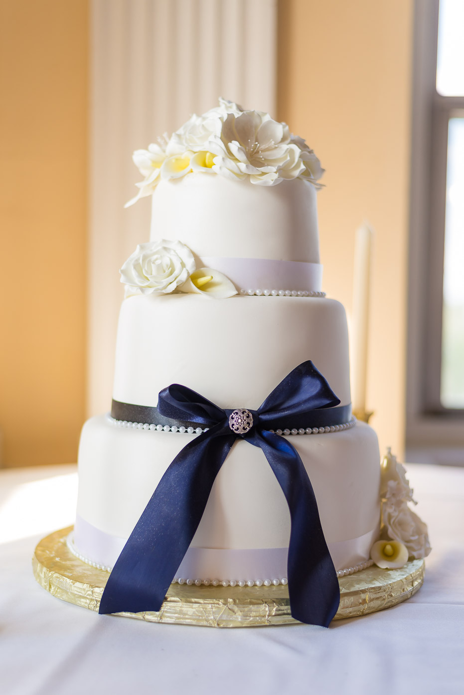 Wedding Cake with Blue Bow and Flowers