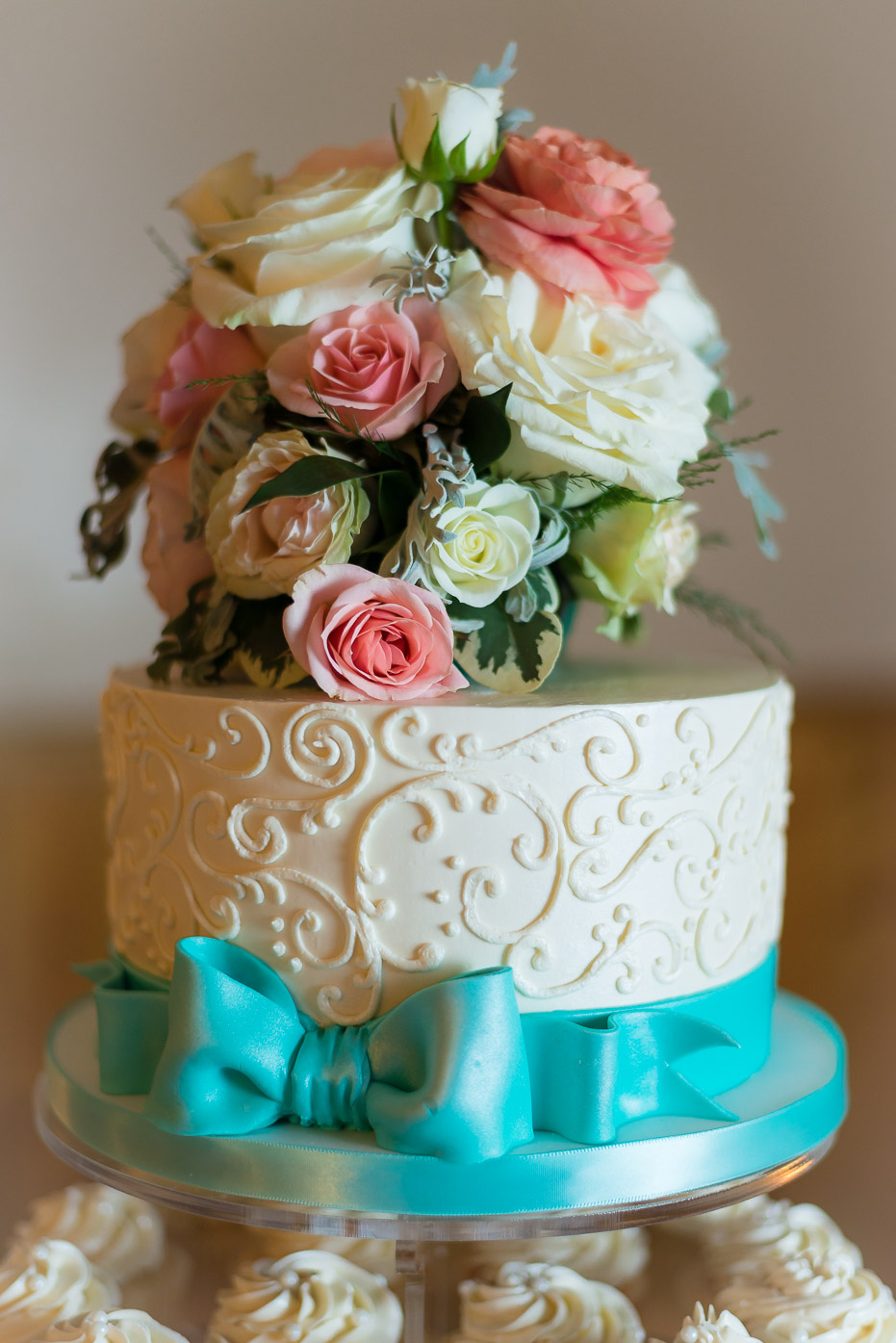 Floral Wedding Cake with Bow and Cupcakes