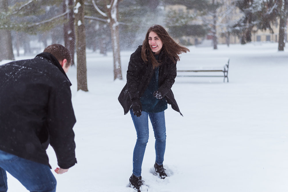 Snowball fight flirting couple