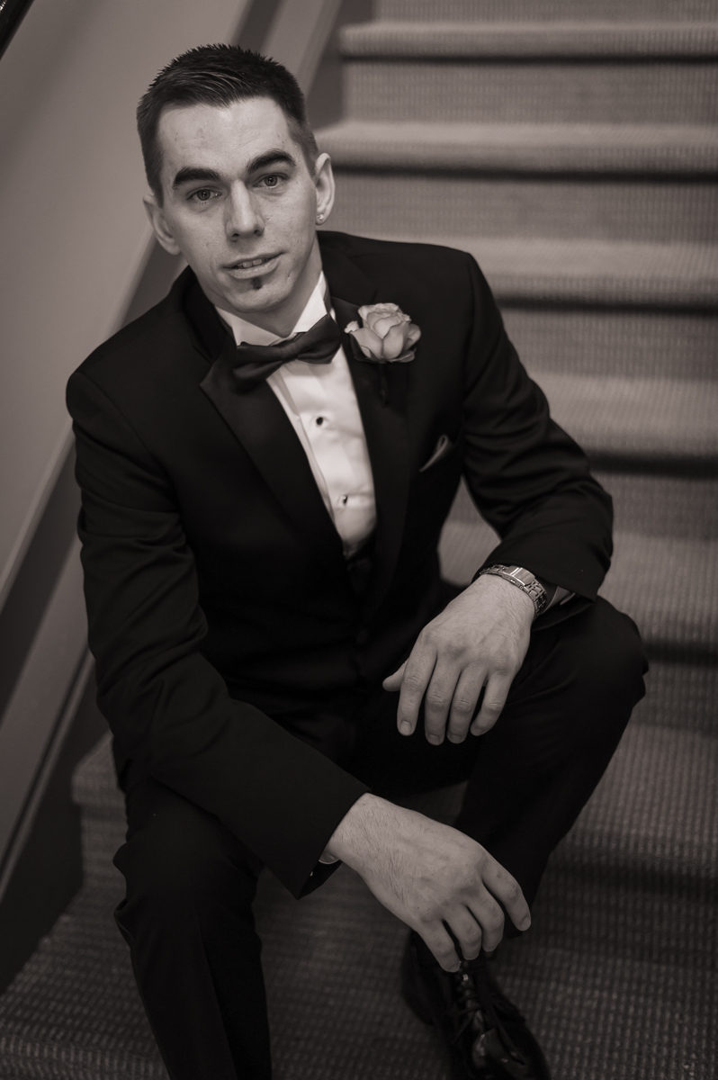 Groom on stairs