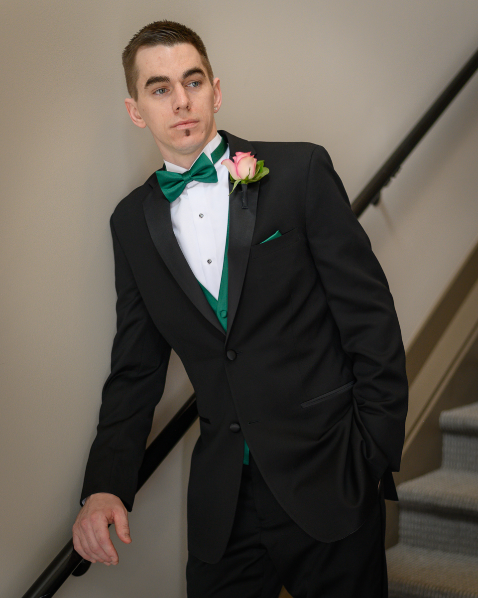 Groom on stairs at apartment