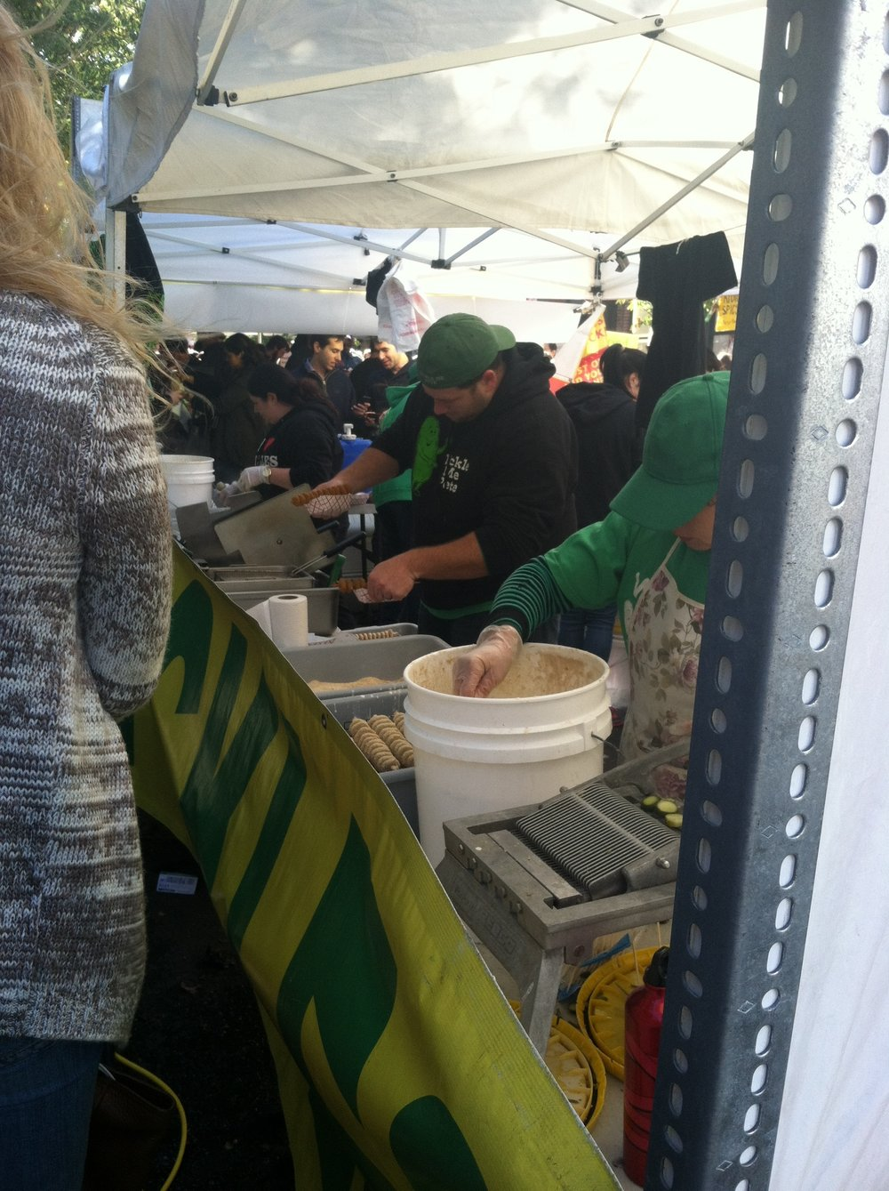 Mahan and I survey the fried pickle operations at NYC's annual  Pickle Day  festival on the Lower East Side.