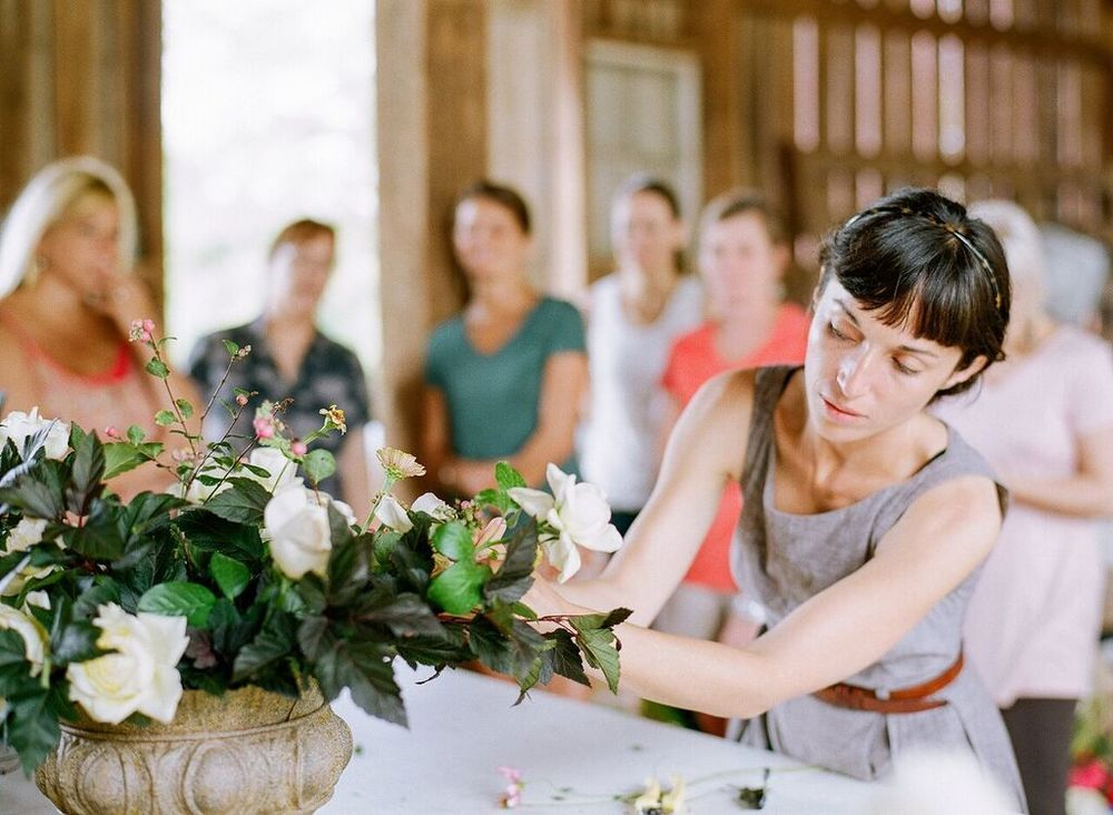 Ariel Dearie, designing at the first Hope Flower Farm workshop. Photo by  Jodi Miller Photography.