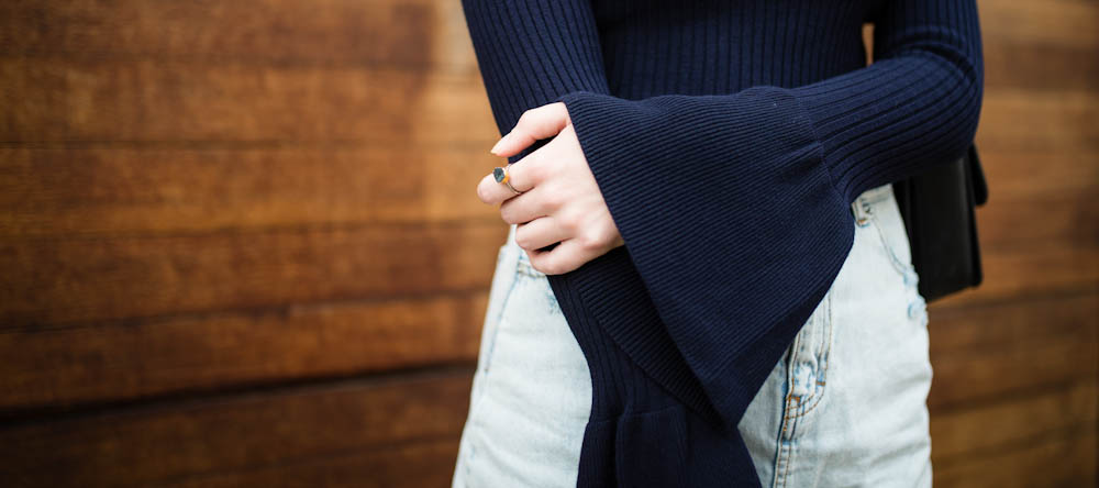 Flared sleeve jumper and ripped hem denim skirt