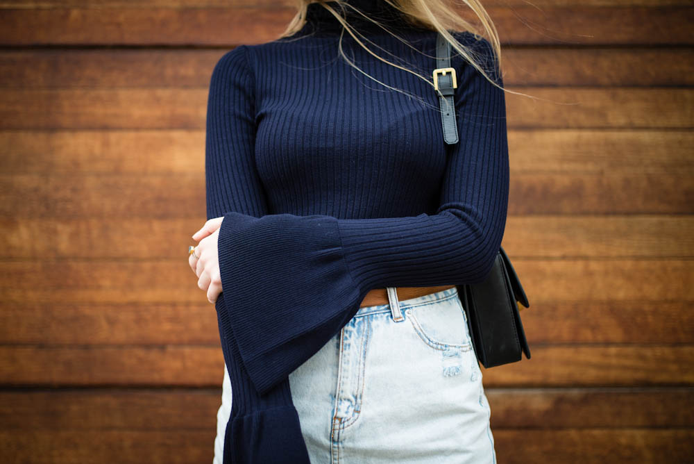 Flared sleeve jumper and ripped hem denim skirt