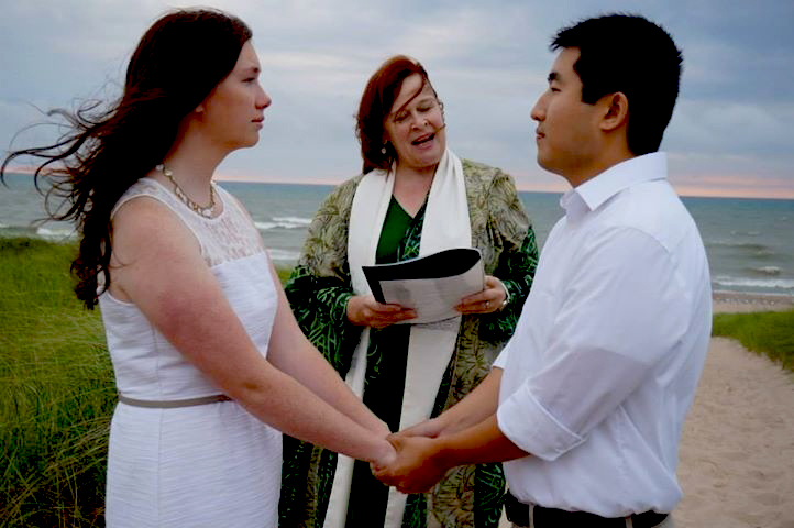 Rev. Rebecca at beach wedding
